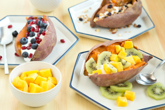 breakfast sweet potatoes topped with fruit and yogurt