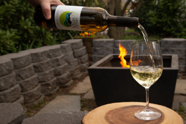 pouring wine at the firepit